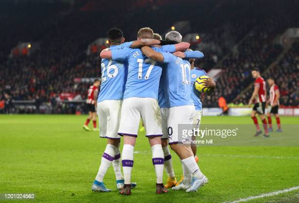 Sergio Aguero of Manchester City celebrates with teammates after scoring his team's first goal during the Premier League match between Sheffield...