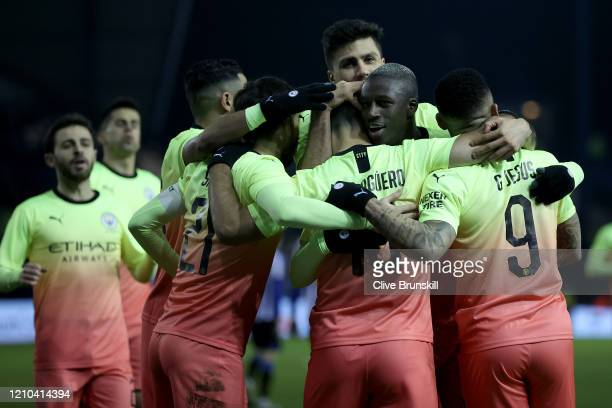 Sergio Aguero of Manchester City celebrates with teammates after scoring his sides first goal during the FA Cup Fifth Round match between Sheffield...