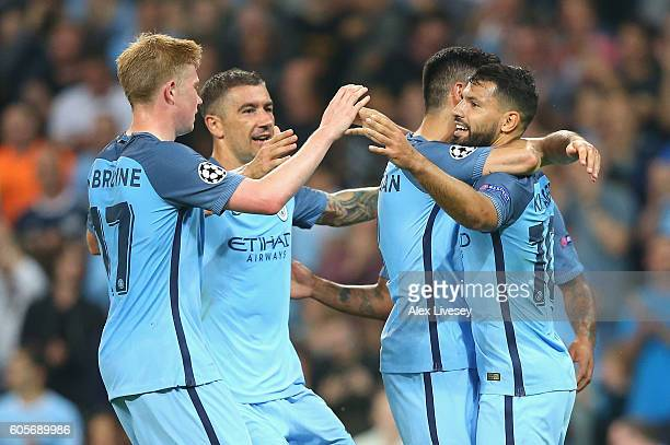Sergio Aguero of Manchester City celebrates with teammates after scoring his second during the UEFA Champions League match between Manchester City FC...