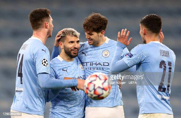 Sergio Aguero of Manchester City celebrates with teammates Aymeric Laporte, John Stones and Ferran Torres after scoring their team's second goal...