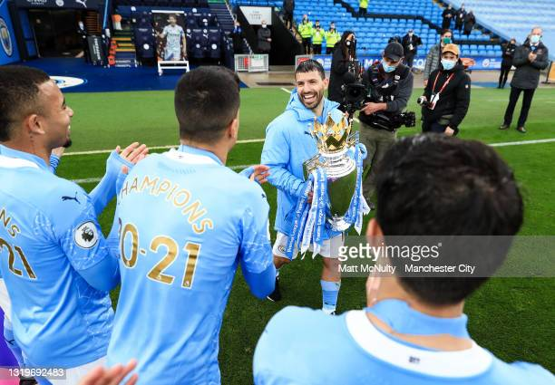 Sergio Aguero of Manchester City celebrates with teammates during the Premier League match between Manchester City and Everton at Etihad Stadium on...