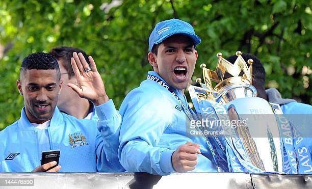 Sergio Aguero of Manchester City celebrates with the Barclays Premier League trophy next to teammate Gael Clichy in front of Manchester Town Hall...