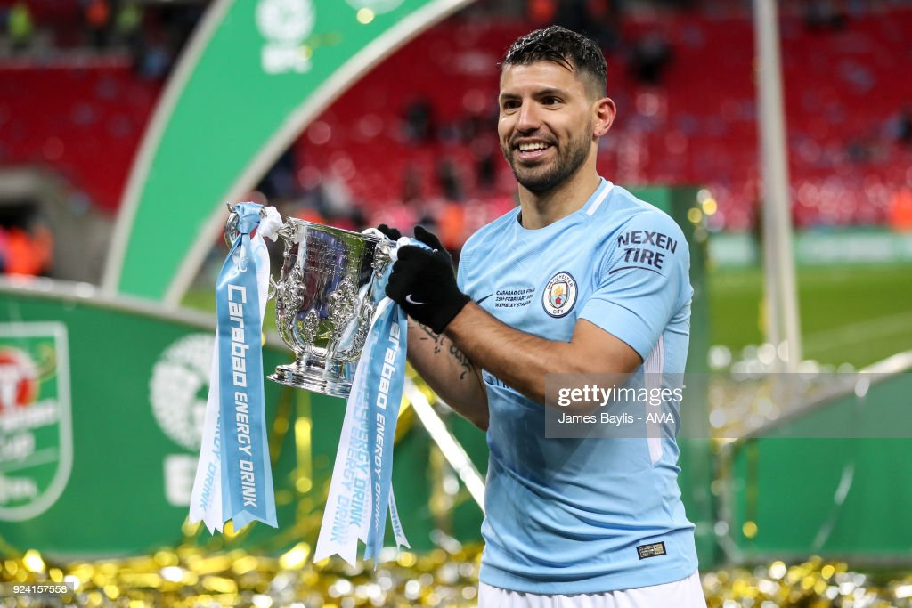 Sergio Aguero of Manchester City celebrates with the Carabao Cup trophy during the Carabao Cup Final match between Arsenal and Manchester City at Wembley Stadium on February 25, 2018 in London, England.