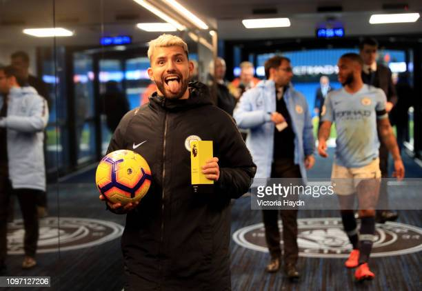 Sergio Aguero of Manchester City celebrates with the match ball in the tunnel after scoring a hat-trick in the Premier League match between...