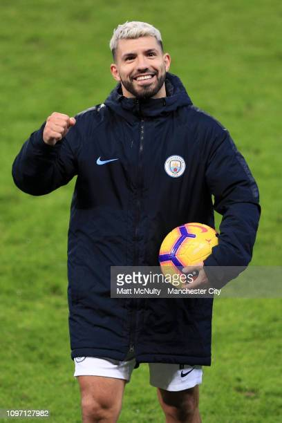 Sergio Aguero of Manchester City celebrates with the matchball at full-time after scoring a hat-trick during the Premier League match between...