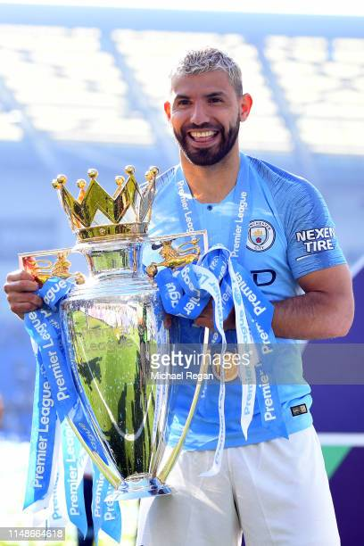 Sergio Aguero of Manchester City celebrates with the Premier League Trophy after winning the title after the Premier League match between Brighton &...