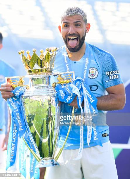 Sergio Aguero of Manchester City celebrates with the Premier League trophy during the Premier League match between Brighton Hove Albion and...