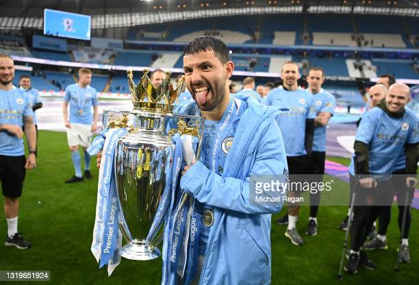 Sergio Aguero of Manchester City celebrates with the Premier League Trophy as Manchester City are presented with the Trophy as they win the league...