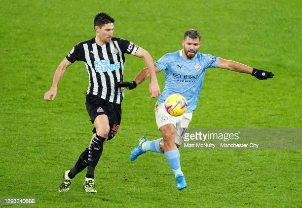 Sergio Aguero of Manchester City challenges Federico Fernandez of Newcastle United during the Premier League match between Manchester City and...