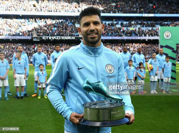 Sergio Aguero of Manchester City collects his award prior to the Premier League match between Manchester City and Arsenal at Etihad Stadium on...