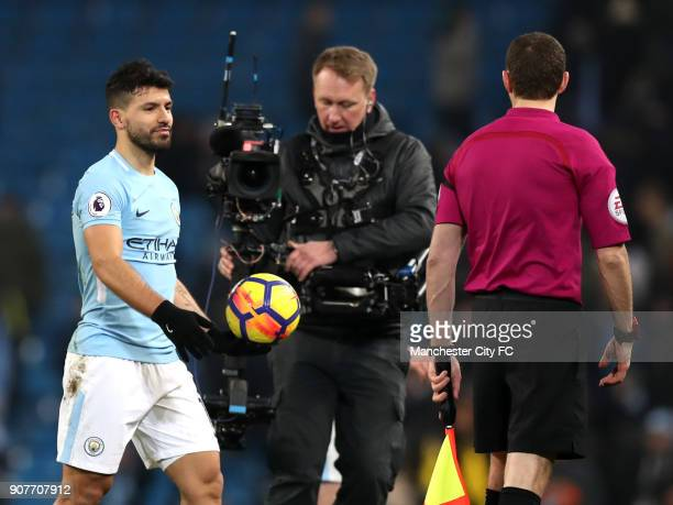 Sergio Aguero of Manchester City collects the match ball after scoring a hattrick during the Premier League match between Manchester City and...