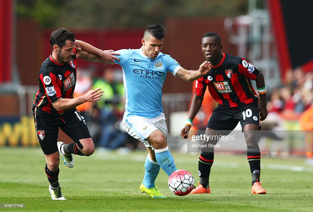 Sergio Aguero (C) of Manchester City competes for the ball against Adam Smith (L) and Max Gradel (R) of Bournemouth during the Barclays Premier League match between A.F.C. Bournemouth and Manchester City at Vitality Stadium on April 2, 2016 in Bournemouth, England.