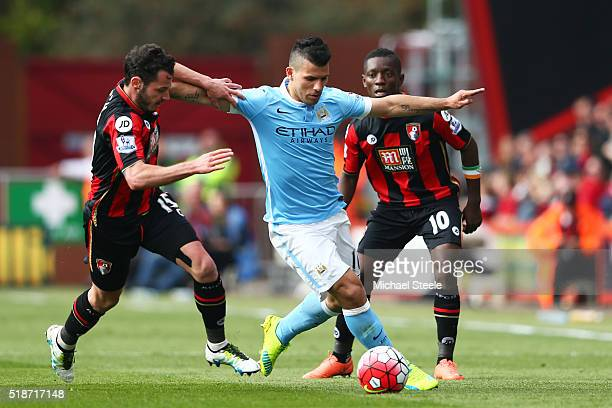 Sergio Aguero of Manchester City competes for the ball against Adam Smith and Max Gradel of Bournemouth during the Barclays Premier League match...