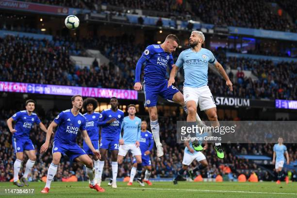 Sergio Aguero of Manchester City competes for the ball in the air with Jamie Vardy of Leicester City during the Premier League match between...