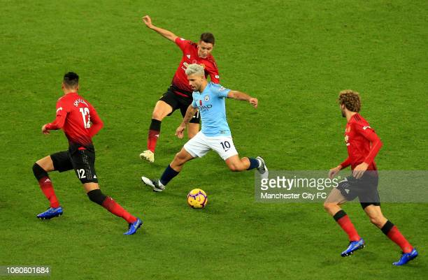 Sergio Aguero of Manchester City competes for the ball with Chris Smalling Ander Herrera and Marouane Fellaini of Manchester United during the...