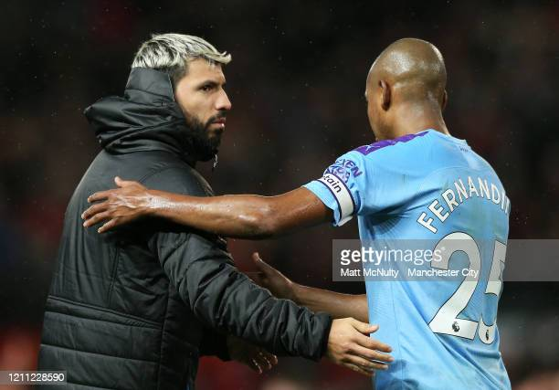 Sergio Aguero of Manchester City consoles Fernandinho at full time during the Premier League match between Manchester United and Manchester City at...