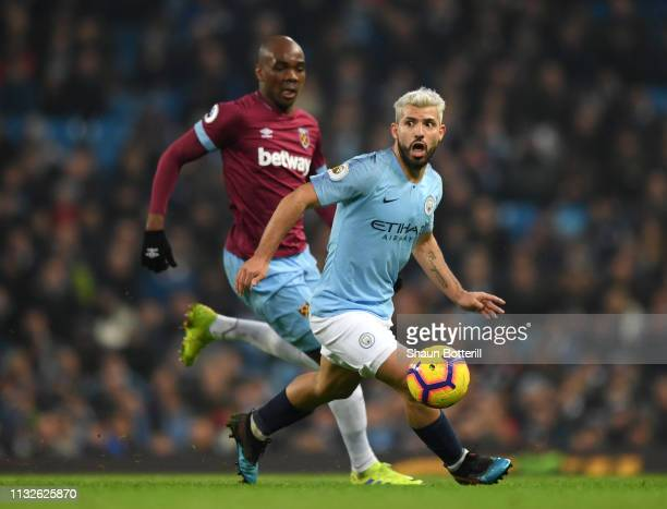 Sergio Aguero of Manchester City controls the ball in front of Angelo Ogbonna of West Ham United during the Premier League match between Manchester...
