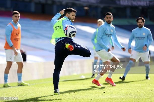 Sergio Aguero of Manchester City controls the ball in the warm up prior to the Premier League match between Manchester City and West Ham United at...