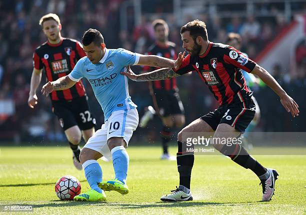 Sergio Aguero of Manchester City controls the ball under pressure of Steve Cook of Bournemouth during the Barclays Premier League match between AFC...