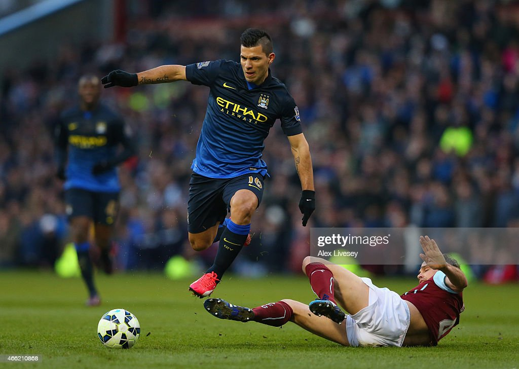 Sergio Aguero of Manchester City evades the challenge Michael Duff of Burnley during the Barclays Premier League match between Burnley and Manchester City at Turf Moor on March 14, 2015 in Burnley, England.