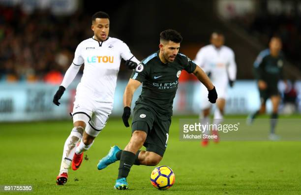 Sergio Aguero of Manchester City gets away from Martin Olsson of Swansea City during the Premier League match between Swansea City and Manchester...