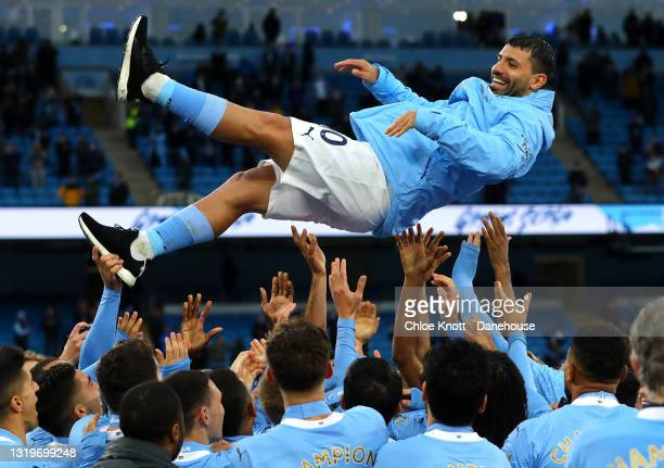 Sergio Aguero of Manchester City gets thrown in the air after the Premier League match between Manchester City and Everton at Etihad Stadium on May...
