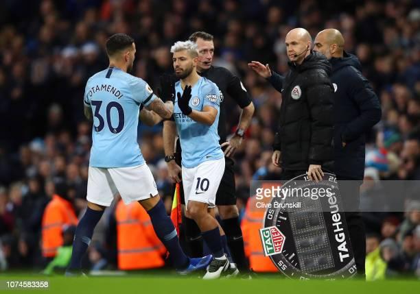 Sergio Aguero of Manchester City greets Nicolas Otamendi of Manchester City as Sergio Aguero is substituted on and Nicolas Otamendi is substituted...
