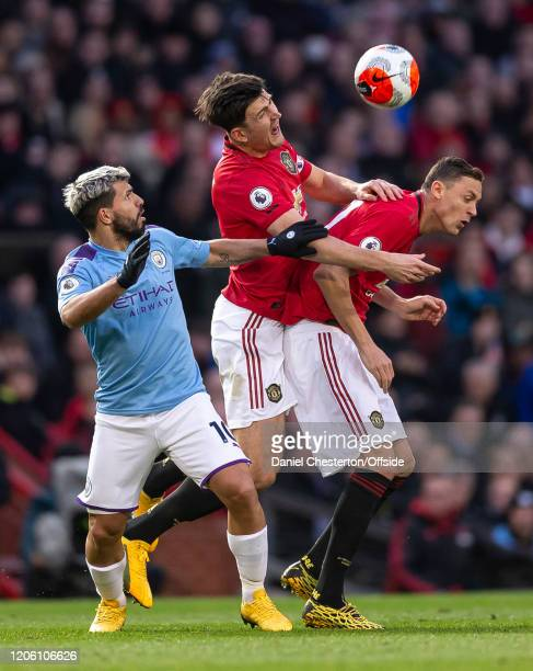 Sergio Aguero of Manchester City Harry Maguire of Manchester United and Nemanja Matic of Manchester United during the Premier League match between...