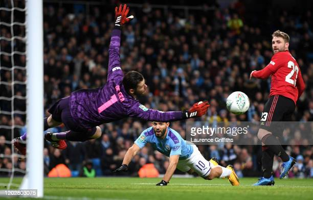 Sergio Aguero of Manchester City has a header saved by David De Gea of Manchester United during the Carabao Cup Semi Final match between Manchester...