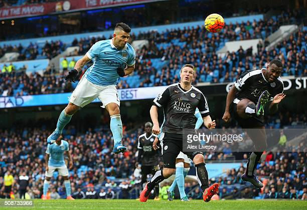Sergio Aguero of Manchester City heads the ball to scores his team's first goal during the Barclays Premier League match between Manchester City and...