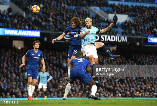 Sergio Aguero of Manchester City heads the ball under pressure from David Luiz of Chelsea during the Premier League match between Manchester City and...