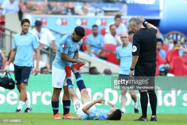 Sergio Aguero of Manchester City helps teammate Phil Foden who goes down injured during the FA Community Shield between Manchester City and Chelsea...