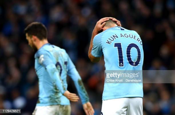 Sergio Aguero of Manchester City holds his head in his hands after missing a shot during the Premier League match between Manchester City and Watford...