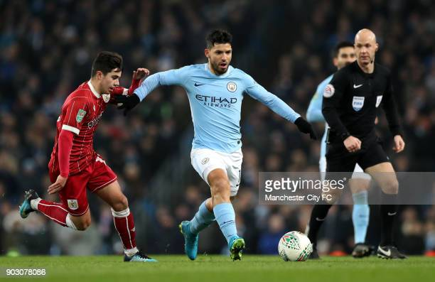 Sergio Aguero of Manchester City holds off Liam Walsh of Bristol City during the Carabao Cup SemiFinal First Leg match between Manchester City and...