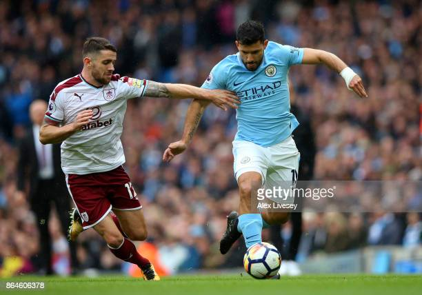 Sergio Aguero of Manchester City holds off Robbie Brady of Burnley during the Premier League match between Manchester City and Burnley at Etihad...