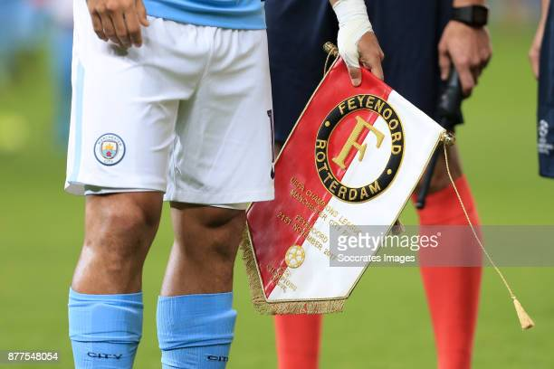 Sergio Aguero of Manchester City holds the commemorative matchday pennant during the UEFA Champions League match between Manchester City v Feyenoord...