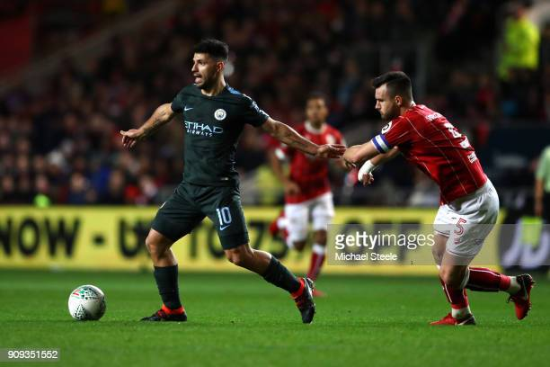 Sergio Aguero of Manchester City in action with Bailey Wright of Bristol City during the Carabao Cup semifinal second leg match between Bristol City...