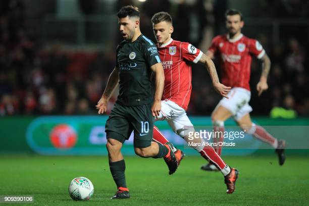 Sergio Aguero of Manchester City in action with Jamie Paterson of Bristol City during the Carabao Cup SemiFinal 2nd leg match between Bristol City...