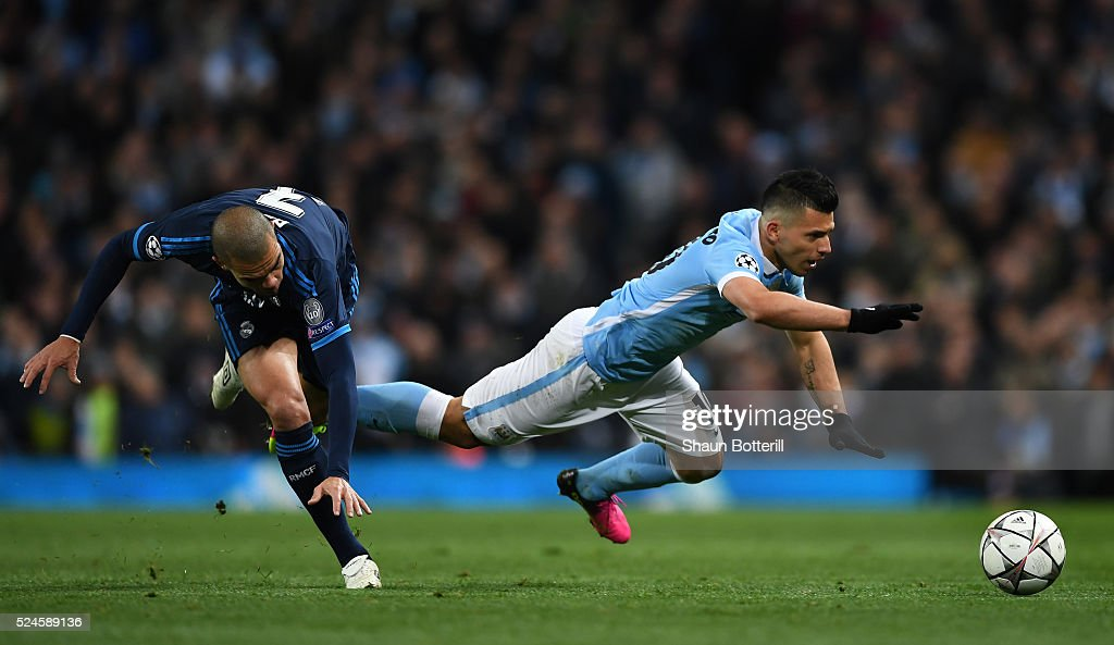 Sergio Aguero of Manchester City is brought down by Pepe of Real Madrid CF during the UEFA Champions League Semi Final first leg match between Manchester City FC and Real Madrid at the Etihad Stadium on April 26, 2016 in Manchester, United Kingdom.