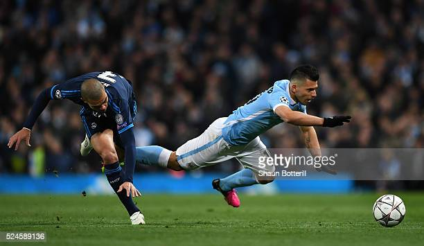 Sergio Aguero of Manchester City is brought down by Pepe of Real Madrid CF during the UEFA Champions League Semi Final first leg match between...
