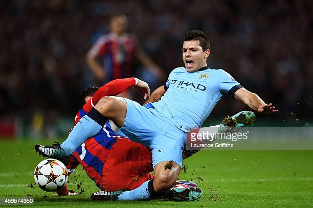 Sergio Aguero of Manchester City is brought down for a penalty by Mehdi Benatia of Bayern Muenchen during the UEFA Champions League Group E match...