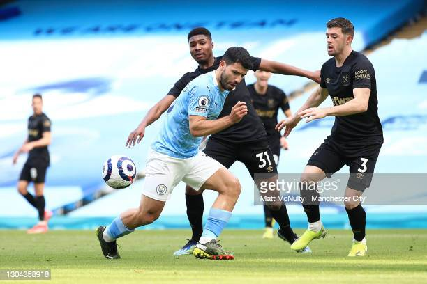 Sergio Aguero of Manchester City is challenged by Ben Johnson and Aaron Cresswell of West Ham United during the Premier League match between...