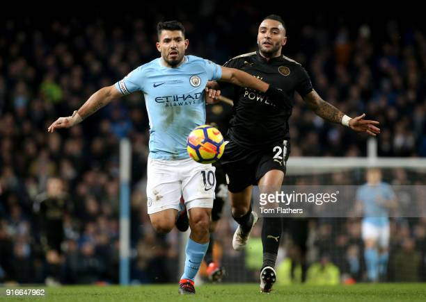 Sergio Aguero of Manchester City is challenged by Danny Simpson of Leiceter City during the Premier League match between Manchester City and...