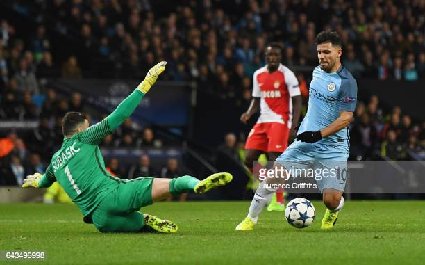 Sergio Aguero of Manchester City is challenged by goalkeeper Danijel Subasic of AS Monaco in the penalty area during the UEFA Champions League Round...