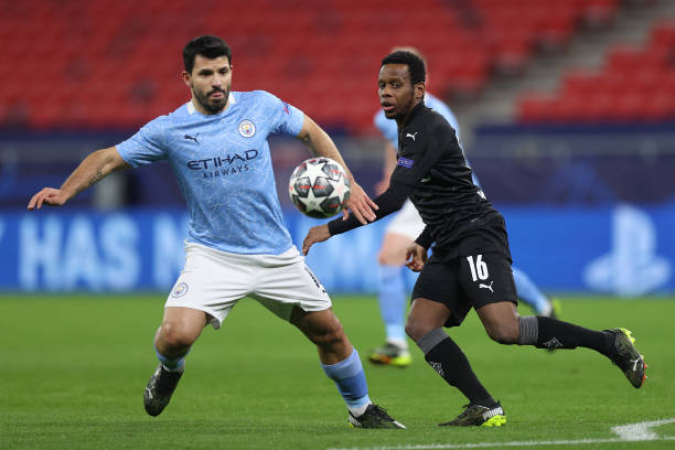 Sergio Aguero of Manchester City is challenged by Ibrahima Traore of Borussia Moenchengladbach during the UEFA Champions League Round of 16 match...