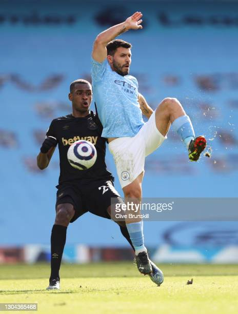 Sergio Aguero of Manchester City is challenged by Issa Diop of West Ham United during the Premier League match between Manchester City and West Ham...