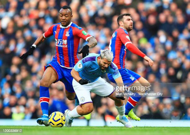 Sergio Aguero of Manchester City is challenged by Jordan Ayew and James McArthur of Crystal Palace during the Premier League match between Manchester...