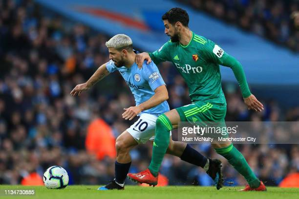 Sergio Aguero of Manchester City is challenged by Miguel Britos of Watford during the Premier League match between Manchester City and Watford FC at...