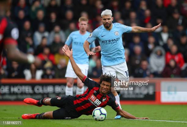 Sergio Aguero of Manchester City is challenged by Nathan Ake of Bournemouth during the Premier League match between AFC Bournemouth and Manchester...