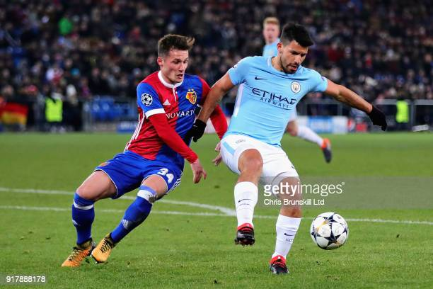 Sergio Aguero of Manchester City is challenged by Taulant Xhaka of FC Basel during the UEFA Champions League Round of 16 First Leg match between FC...